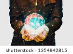 Small photo of Double exposure- polygon and dot line technology businessman uses hands embrace world with energy bursting to energize spirits of life with glittering lights,Elements of this image furnished by NASA