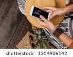 stylish woman using mobile... | Shutterstock . vector #1354906142