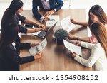 businesswoman in group meeting... | Shutterstock . vector #1354908152