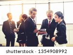 many young businessmen and... | Shutterstock . vector #1354908992
