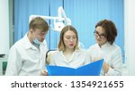 team of doctors discuss... | Shutterstock . vector #1354921655