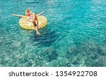female swims on inflatable... | Shutterstock . vector #1354922708