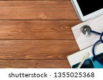 high angle shot of tablet and... | Shutterstock . vector #1355025368