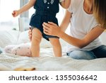 baby learning to walk | Shutterstock . vector #1355036642