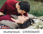 a young couple in love on picnic | Shutterstock . vector #1355036645