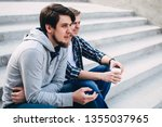 two guys sit and talk | Shutterstock . vector #1355037965