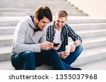 two guys sitting on the steps... | Shutterstock . vector #1355037968