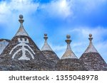 the traditional trulli houses... | Shutterstock . vector #1355048978