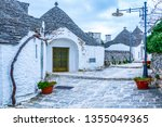 the traditional trulli houses... | Shutterstock . vector #1355049365
