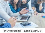 team of coworkers discussing... | Shutterstock . vector #1355128478