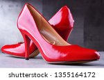 composition with a pair of red... | Shutterstock . vector #1355164172