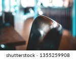 the back of a chair basking in... | Shutterstock . vector #1355259908