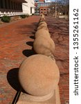 A Row Of Spherical Bollards At...