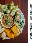 Stock photo nam prik pla to thai chili paste dip with mackerel fish meat and fresh vegetables pumpkin 1355308385