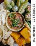 Stock photo nam prik pla to thai chili paste dip with mackerel fish meat and fresh vegetables pumpkin 1355308388