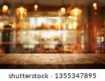 image of wooden table in front... | Shutterstock . vector #1355347895