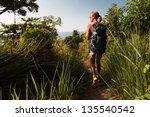 hiker with backpack walking... | Shutterstock . vector #135540542