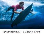 surfers dive under the breaking ...   Shutterstock . vector #1355444795