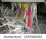 paper into shredder machine.... | Shutterstock . vector #1355460302