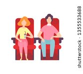 Couple Sitting In Cinema...