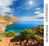 Small photo of Sunshiny paradise sea bay with azure water and beach view from coastline trail of Zingaro Nature Reserve Park, between San Vito lo Capo and Scopello, Trapani province, Sicily, Italy