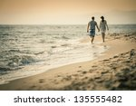 couple lovers walking on the... | Shutterstock . vector #135555482