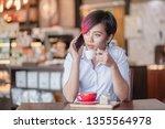 short hair and purple hair she... | Shutterstock . vector #1355564978