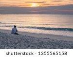 white sand beach in the morning ... | Shutterstock . vector #1355565158