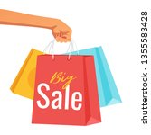 hand holding paper sale bags...   Shutterstock .eps vector #1355583428