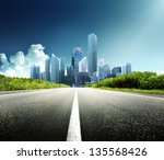 asphalt road and modern city | Shutterstock . vector #135568426
