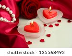 beautiful candles and rose on... | Shutterstock . vector #135568492