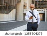 satisfied african businessman... | Shutterstock . vector #1355804378