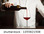 male sommelier pouring red wine ... | Shutterstock . vector #1355821508