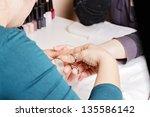 closeup of a manicurist filing...   Shutterstock . vector #135586142