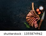 grilled dry aged tomahawk steak ... | Shutterstock . vector #1355874962