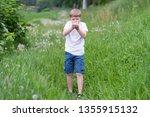 portrait of a beautiful boy... | Shutterstock . vector #1355915132