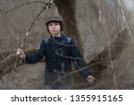 portrait of a boy in a coat and ... | Shutterstock . vector #1355915165