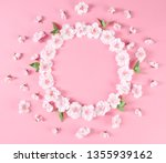 frame with flowers on pink... | Shutterstock . vector #1355939162
