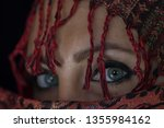 arab lady from afghanistan with ... | Shutterstock . vector #1355984162