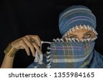 arab lady from afghanistan with ... | Shutterstock . vector #1355984165