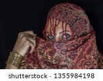 arab lady from afghanistan with ... | Shutterstock . vector #1355984198