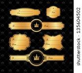 golden gift tags on damask...   Shutterstock .eps vector #135604502