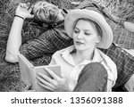 man and girl lay on grass... | Shutterstock . vector #1356091388