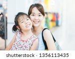 laughing attractive asian... | Shutterstock . vector #1356113435