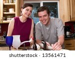 attractive couple smiling while ... | Shutterstock . vector #13561471
