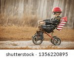 boy in the image of a rider and ... | Shutterstock . vector #1356220895