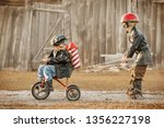 boys in the image of a rider... | Shutterstock . vector #1356227198