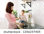 mother with her little baby... | Shutterstock . vector #1356257405