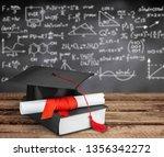 graduation mortarboard on  book ... | Shutterstock . vector #1356342272