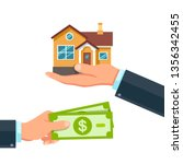 buying a property. hands with a ...   Shutterstock .eps vector #1356342455